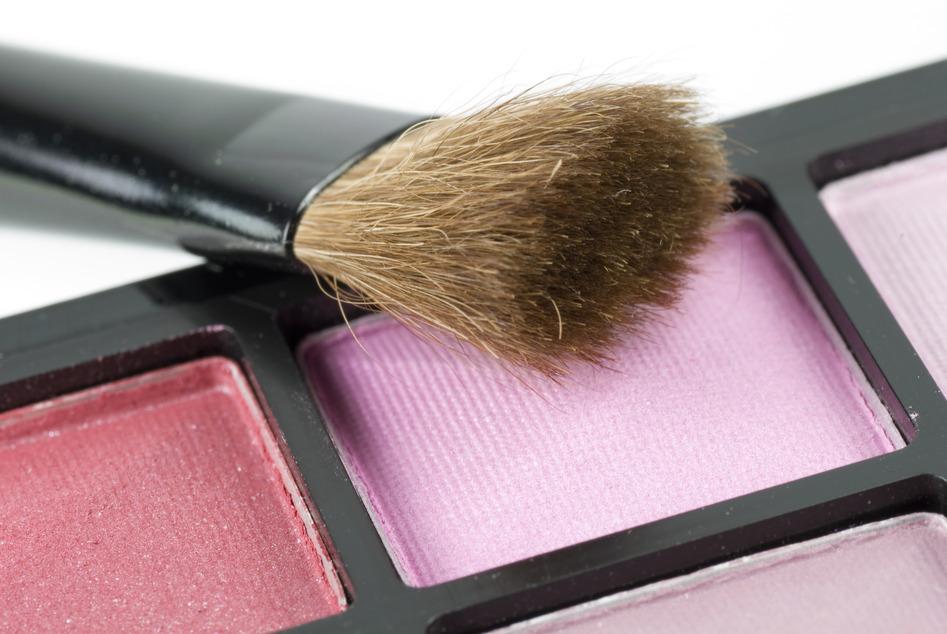 Closeup shot of blusher accompanied with brush
